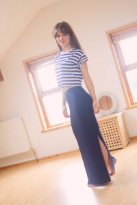 Smiling brunette teen wearing navy maxi skirt