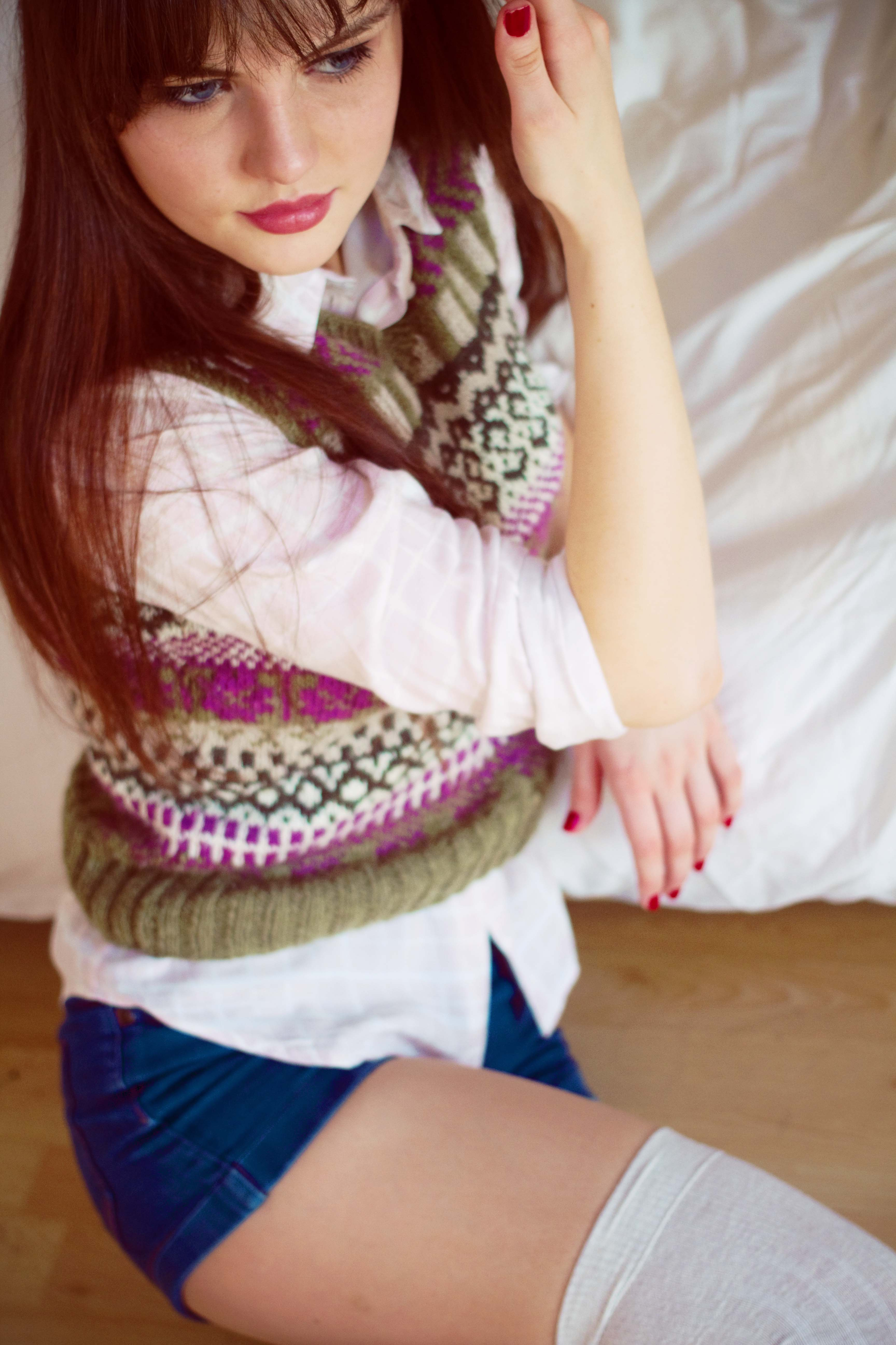 Teen blogger wearing hand-knit Fair Isle vest top and denim shorts