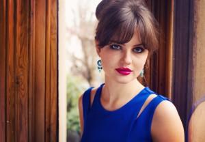 teen wearing magenta lipstick and split shoulder prom dress