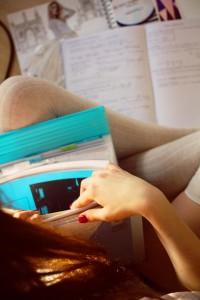 UK teen blogger looking through school work