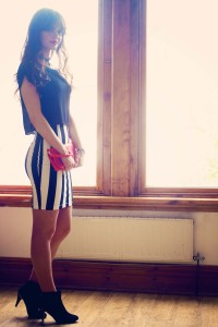 Teen girl wearing black and white stripe bodycon dress