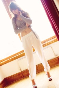 Teen wearing relaxed fiot white joggers and cropped ballet style cardigan