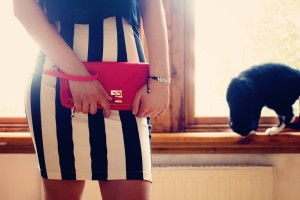 Black and white bodycon sckirt and red padlock clutch