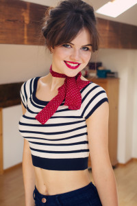 Smiling teen wearing Primark off the shoulder top and red spotted scarf