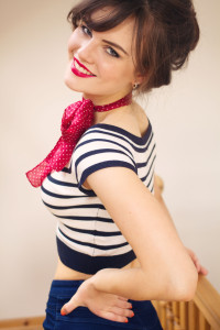 Teen girl wearing striped Bardot top with spotted scarf