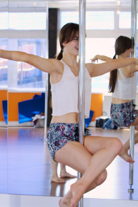 Pole sit at first pole fitness lesson at ECN Blackpool
