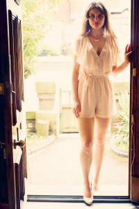 Girl wearing chiffon frill playsuit