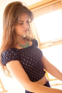 Teen wearing navy print top
