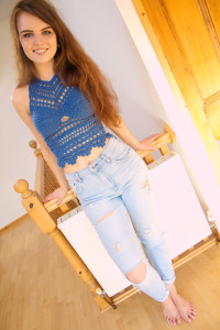 Blue crochet halter worn with Mom style jeans