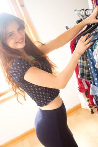 Teen blogger looking through clothes rail