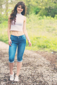 Teen girl wearing cropped jeans and high neck cropped top