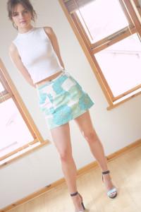 Teen girl wearing Top Shop skirt with H & M heels