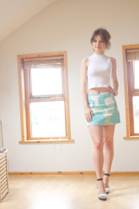 Teen girl wearing Top Shop skirt and white sleeveless top