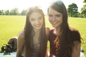 Smiling teens in backlit park shot