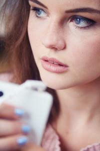 Blogger Lily Kate France using Sudio Klang earphones