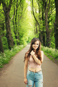 Teen girl photographed in avenue of trees