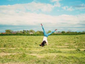Teen blogger doing cartwheel