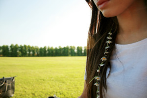 Brunette teenager with daisy chain in hair