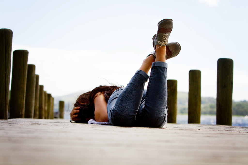 girl-laid-on-Coniston-jetty