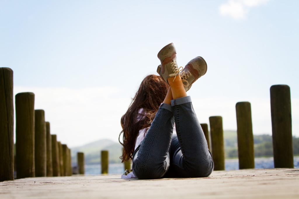 girl-lying-on-coniston-jetty