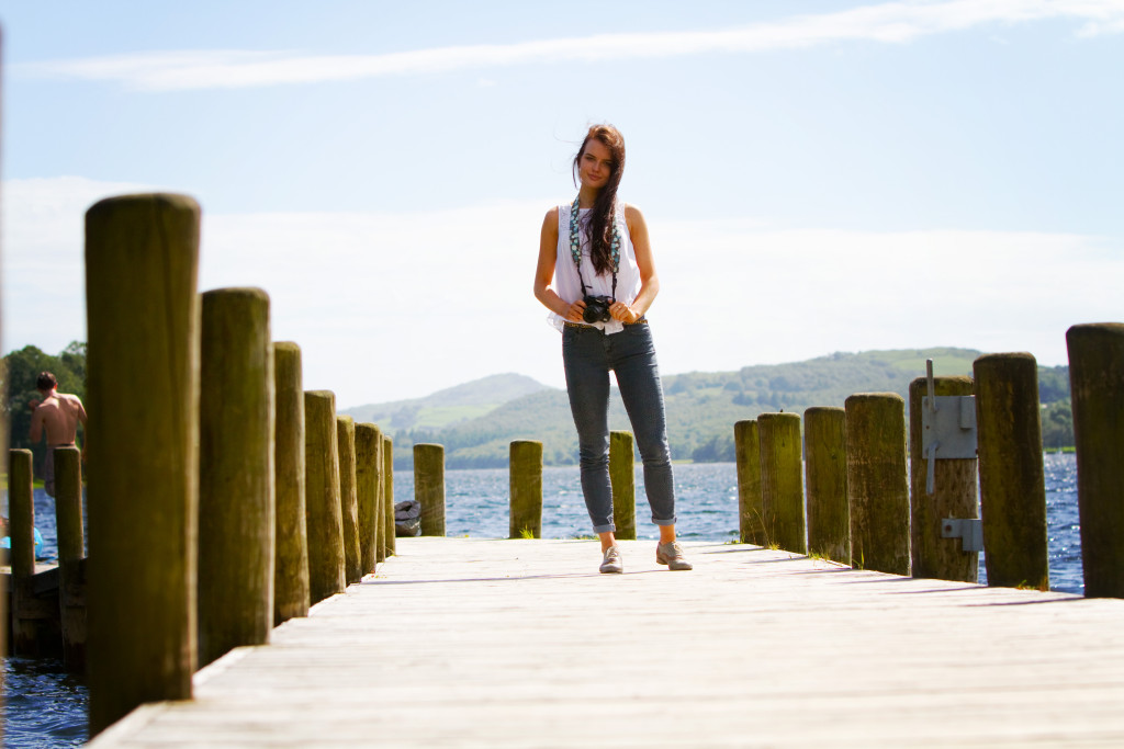 girl-stood-with-camera-on-coniston-pier
