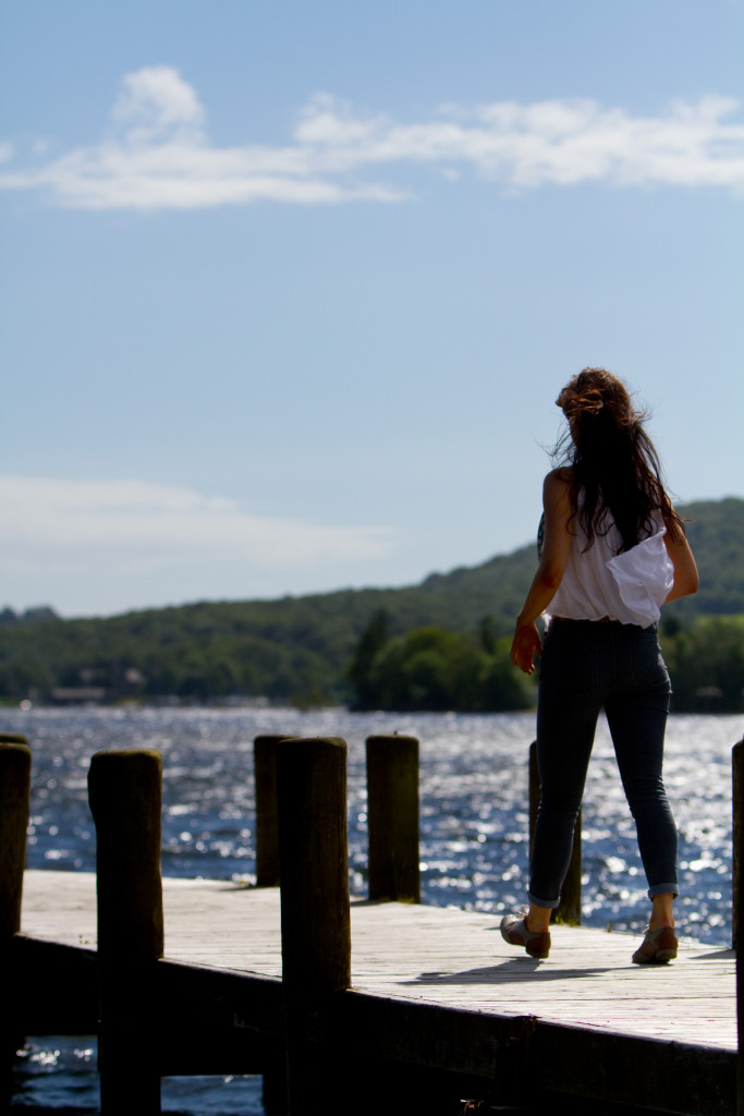 girl-striding-along-coniston-jetty