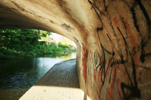 Graffiti sprayed on underside of canal bridge