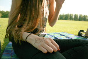 Girl with henna hand on park picnic