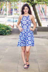 Girl wearing blue and white patterned high neck dress