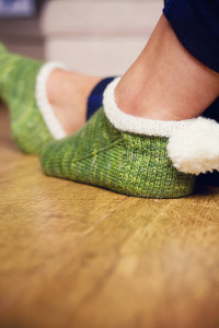 Green anklet socks with pom pom heel detail. Purl Soho