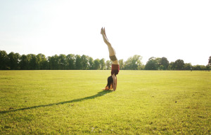 Teen blogger doing handstand