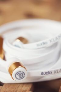 White and gold Sudio Klang earphones