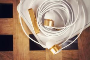 White and gold Sudio earphones