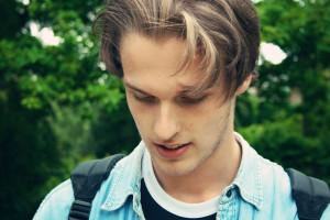 Teen boy with longish hair