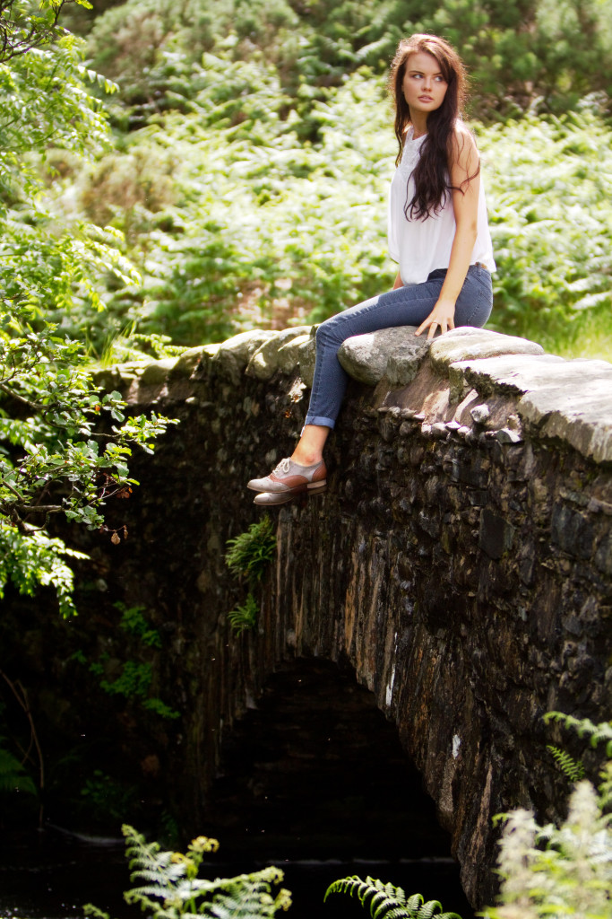 teen-girl-sitting-on-bridge