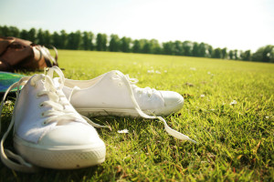 White New Look plimsolls photographed on grass