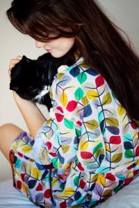 Teen girl cuddling black and white cat. Kimono from Uncommon Goods