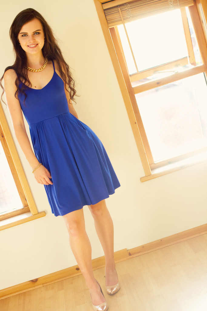 smiling-blogger-wearing-blue-dress
