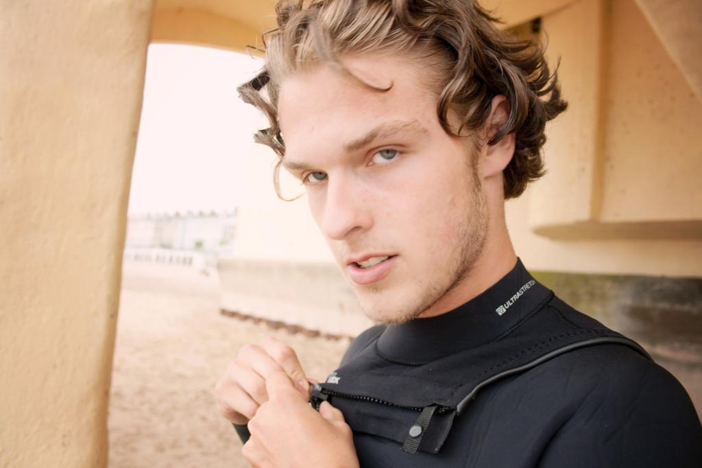 under-pier-in-wetsuit