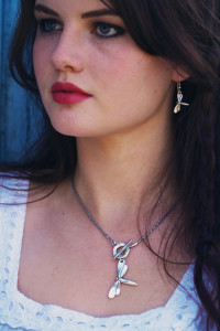 Teen wearing dragonfly necklace and earrings