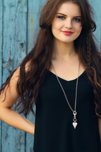 Black camisole vest top worn with heart drop necklace by Danon from Styleican