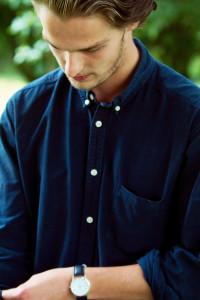 Teen boy wearing dark blue button collar shirt