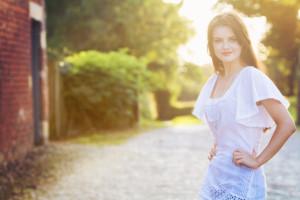 Backlit portrait of teen wearing summer boho outfit. Senior portrait idea. jolihouse.com