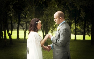 Wedding photography. Bride wearing medieval style dress holding hands with groom