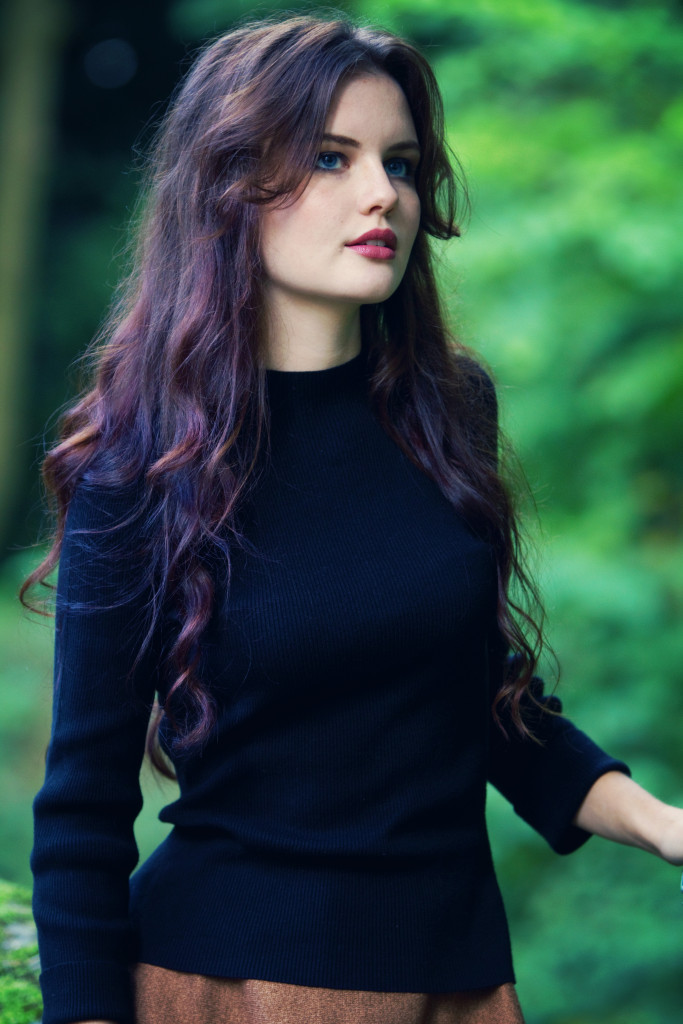 brunette-against-leafy-background