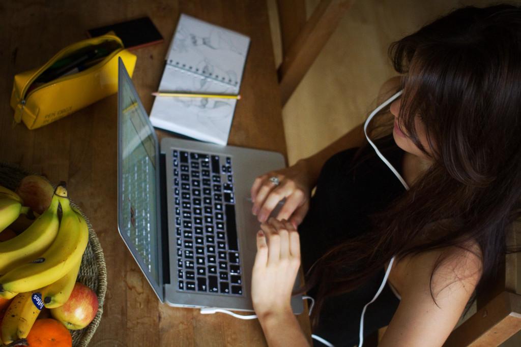 teen-girl-working-at-laptop