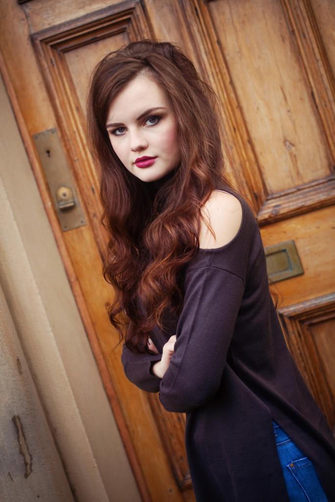 brunette-wearing-cold-shoulder-top
