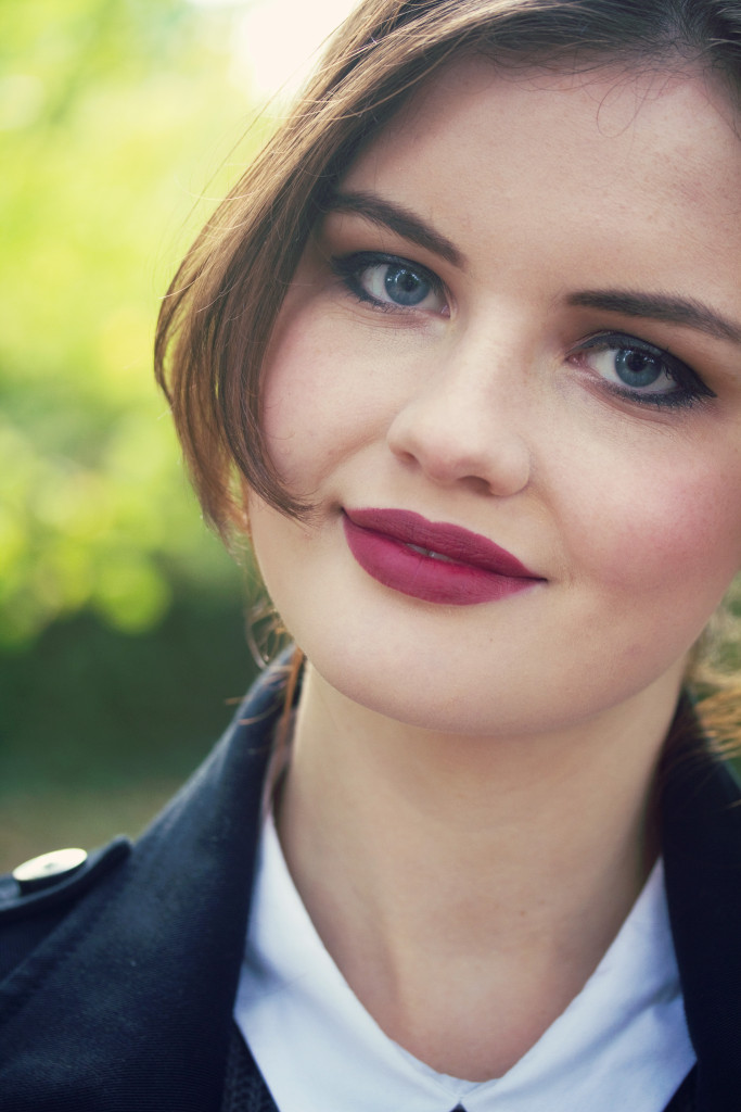 smiling-brunette-wearing-plum-lipstick