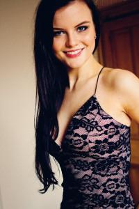 Smiling wearing AX Paris bodycon dress