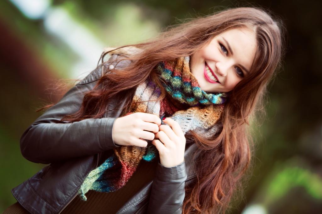 smiling-brunette-teen-wearing-handknit-scarf
